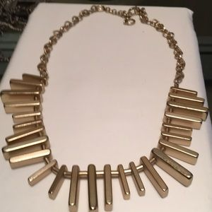 Gold tone choker necklace